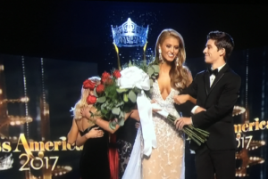 Wyatt after she is named first runner-up to Miss America 2017 -- cleavage is still there, but maybe the flowers will help to conceal any potential wardrobe malfunctions